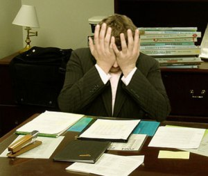 "By LaurMG. (Cropped from ""File:Frustrated man at a desk.jpg"".) [CC-BY-SA-3.0 (http://creativecommons.org/licenses/by-sa/3.0)], via Wikimedia Commons"